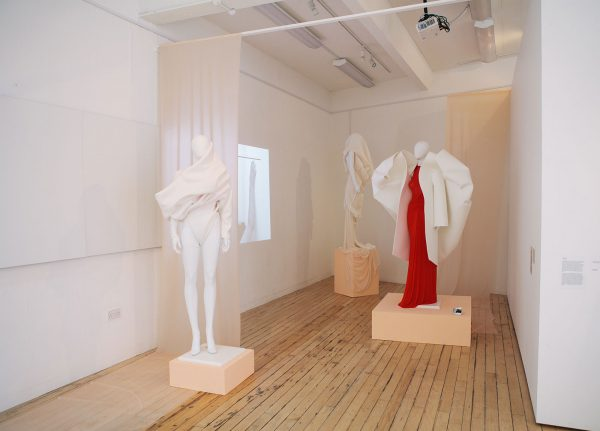 Amy Ollett - Image of mannequins with a red and white garment on