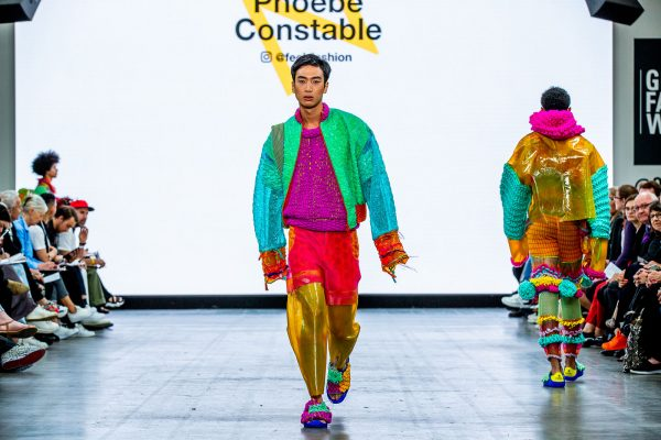 Phoebe Constable - Model wearing eco and sustainable plastic walks down the catwalk at Graduate Fashion Week in colourful clothes by Phoebe Constable