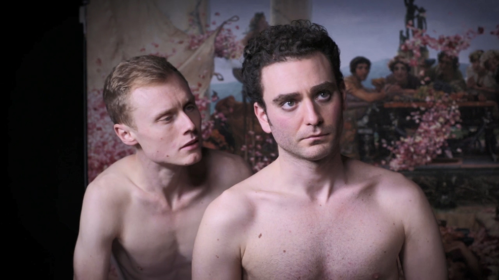 Screencap from Matt Nodwell's film Elgabalus Lives showing two topless men.
