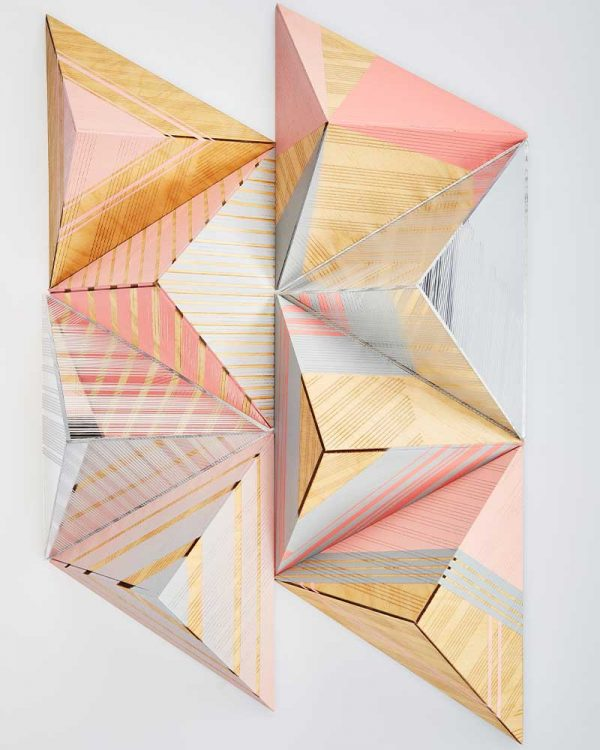 Laura Hackette - Image of hand painted wooden pyramids painting with pastel coloured shapes and lines