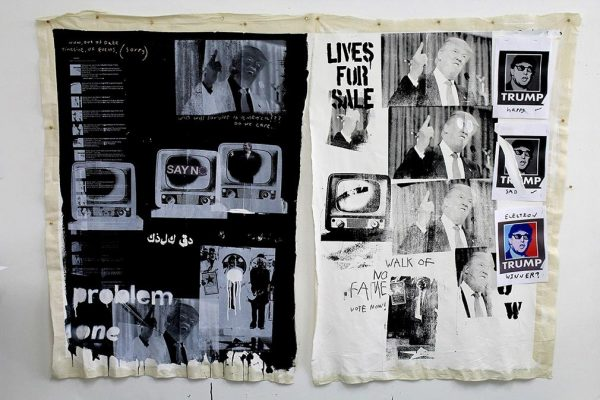 - photo of mounted work on fabric shows two pieces displaying a black print with grey white print depicting US president donald trump and various text titles and the other on white with more images and writing