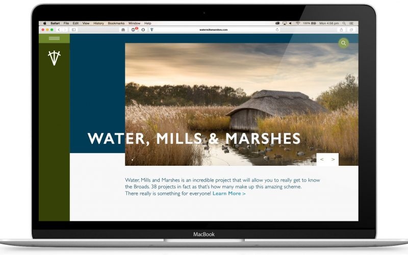 website concept for Water Mills and Marshes associated with the norfolk broads shows offset image with blue and white background and white title near the centre