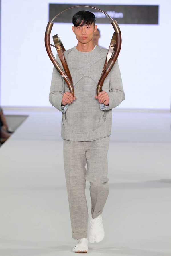 Bryan Wan - Image a model wearing a grey tailored outfit