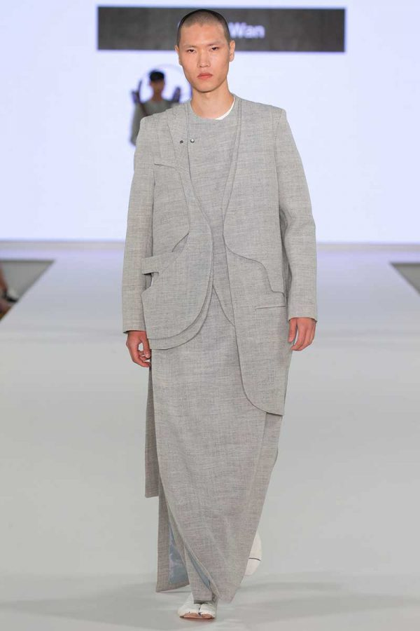 Bryan Wan - Image of a male model wearing a tailored grey outfit