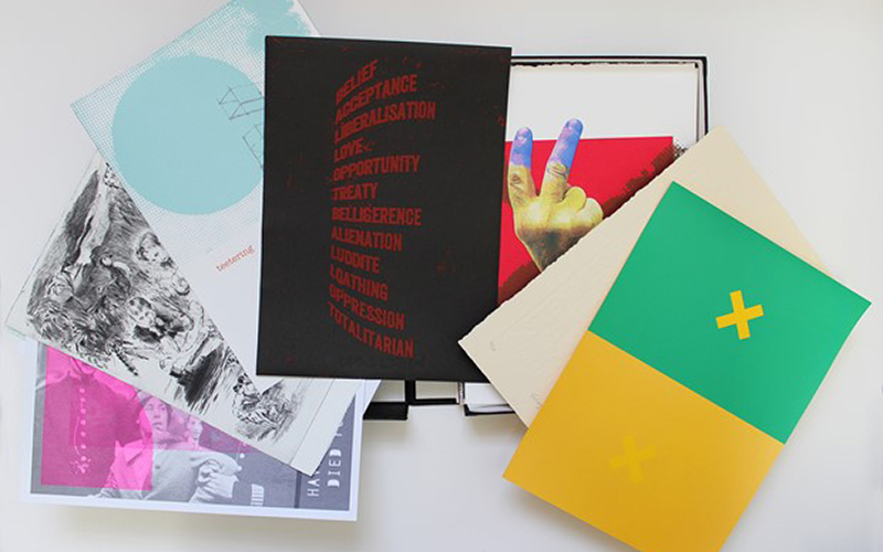photo of designs arranged in a fan layout showing various colours and designs including typograhy, photography,illustration and graphic design photographed vertically on a white background