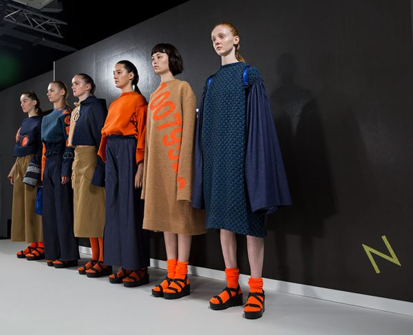 Daisy Clarke - Image of models on the catwalk wearing navy and orange designs