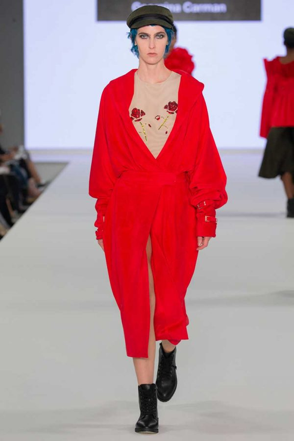 Georgina Carman - Image of a female model wearing a red garment on a catwalk