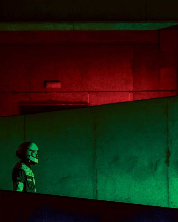 Hannah Gordon-Smith - Image of a ma dressed in a space suit in a red and green background