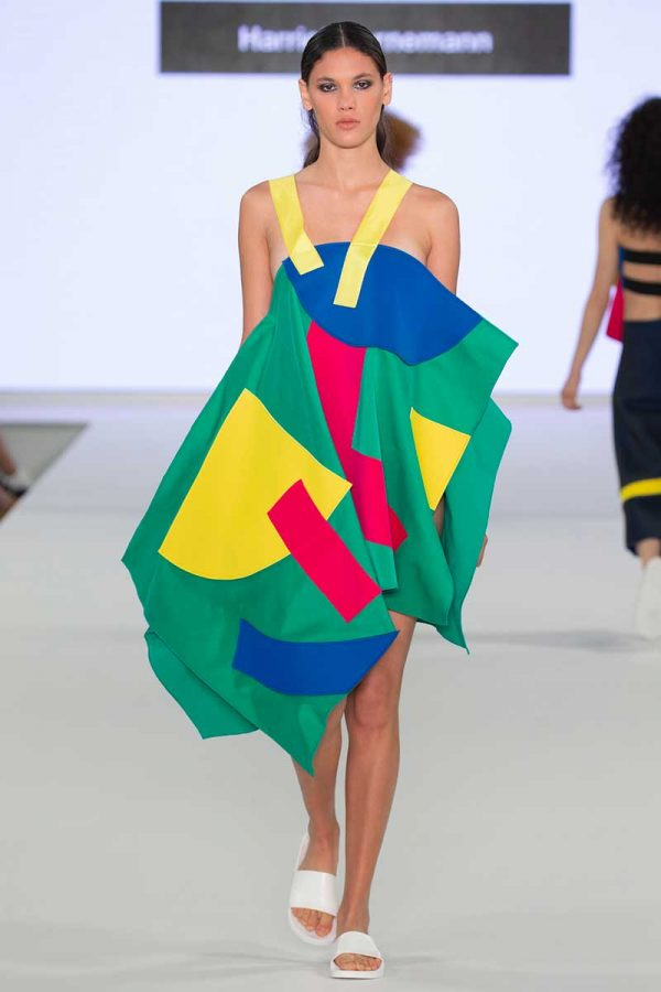Harriet Bornemann - Image a a model wearing a garment made of bright coloured panels