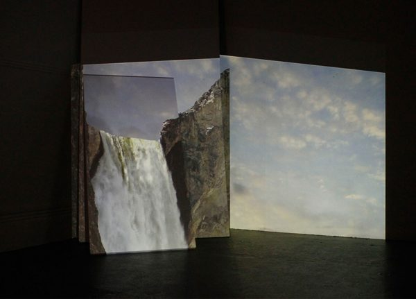 James Quinn - Image of three screens with waterfall projected onto them
