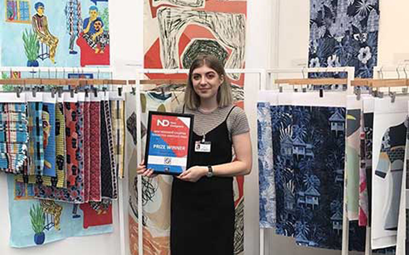 NUA student Amelia Ellwood poses with Kalopsia Associate Prize award next to work