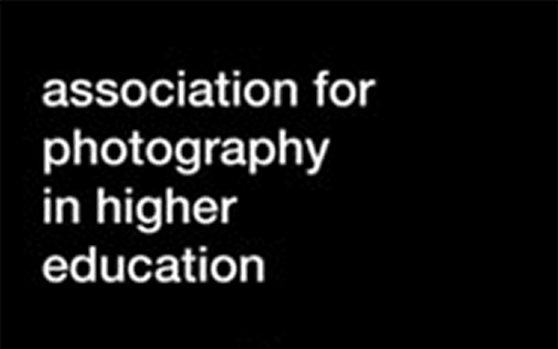 Black background with white text for the Association for Photography