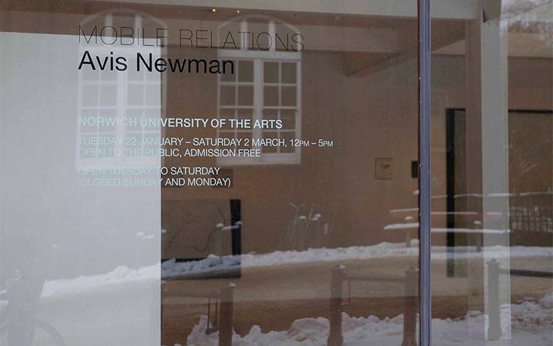 photo of NUA East Gallery shows Mobile Relations exhibition information transfer on glass