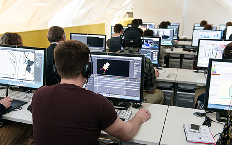 photo shows students at NUA working on computers in the Media Lab