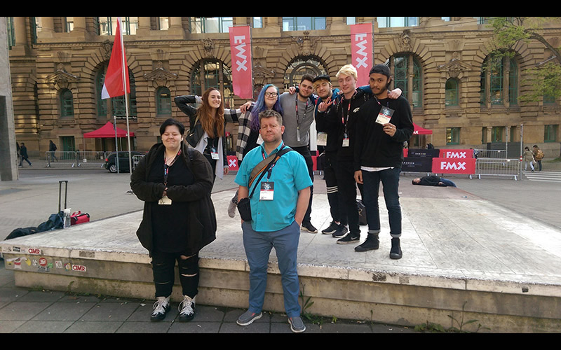 photo of VFX students and course leader Saint Walker posing on a visit to FMX festival