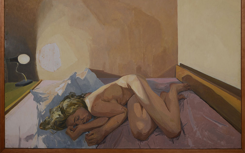 painting by John Wonnacott depicts nude woman loosely curled on a bed with light from a lamp reflecting against the plain walls