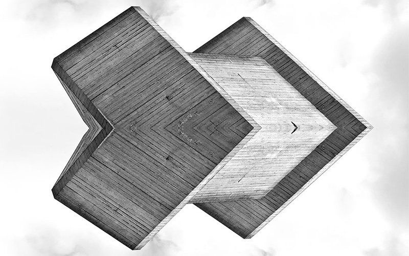 3D abstract object consisting of wooden boards uses symmetry to reflect its shape and create an illusion of dimensions