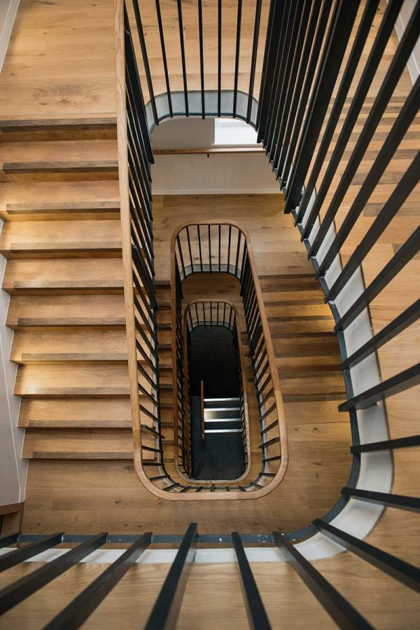 Cavendish House - photo looking down center of circular staircase in NUAs ideas factory shows wooden stairs leading down 3 flights