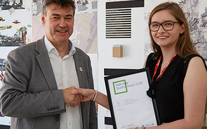 photo of alum Tamsyn-Sydonia Rootsey-Freeman holding award and shaking hands with RIBA East chairman Jon Greenfield