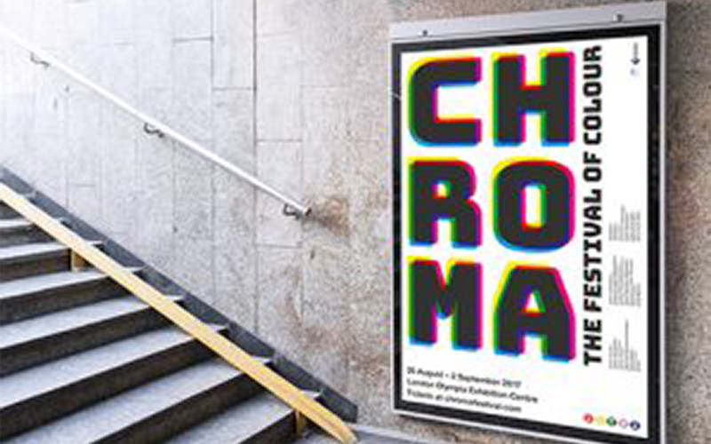 photo of poster in public area reading chroma in large font to advertise the festival of colour