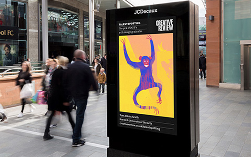 photo of student work displayed on public digital screen to advertise creative review event