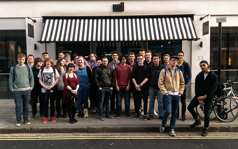 photo of VFX students standing in entrance on trip to The Mill Studio