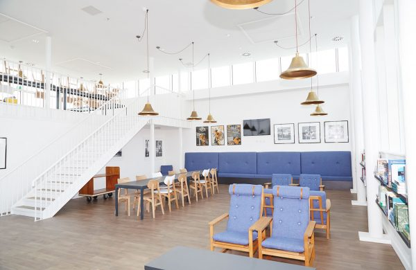 - All Saints Green interior showing communal space with chairs and tables at NUA that you can see on the Open Day