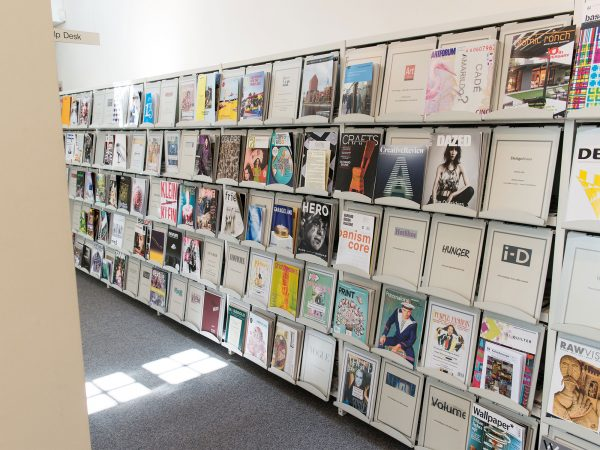 - Image of publications on shelving in the library
