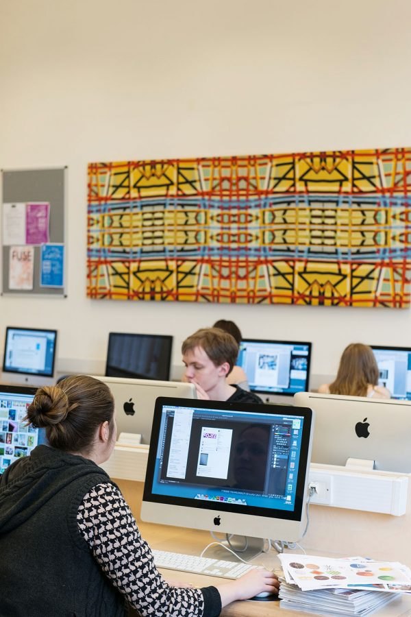 - Image of students on computers in a library