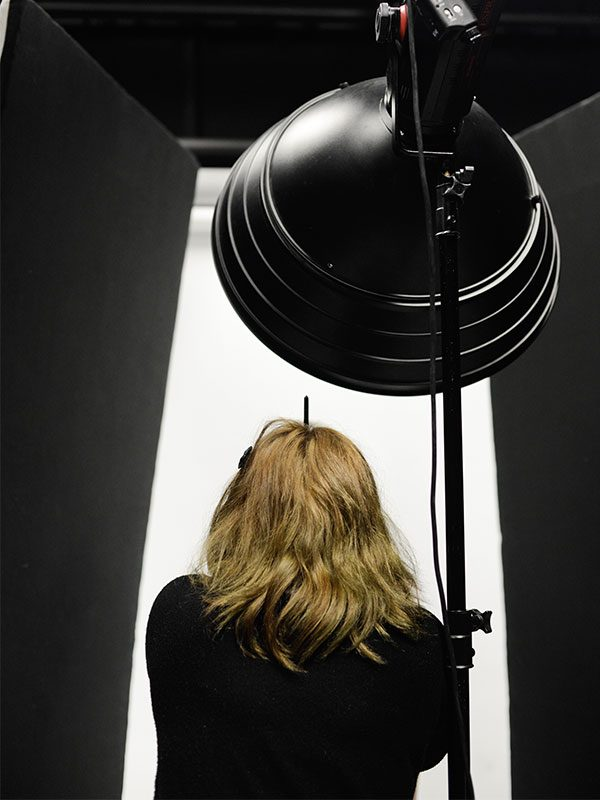 - Image of a student shooting in the Photography studio