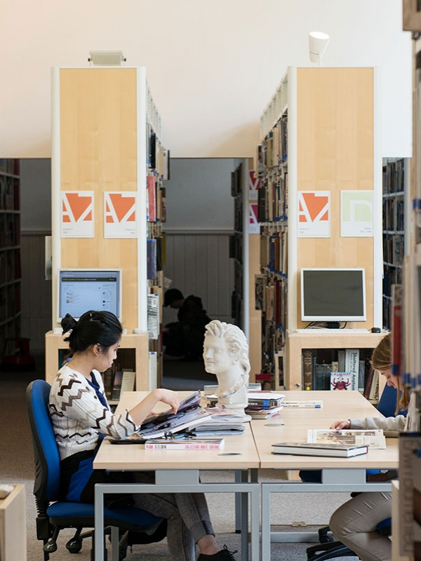 Image of a student working in the NUA Library