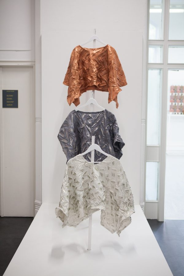 - Three textile design garments hanging in the BA Degree Show 2017