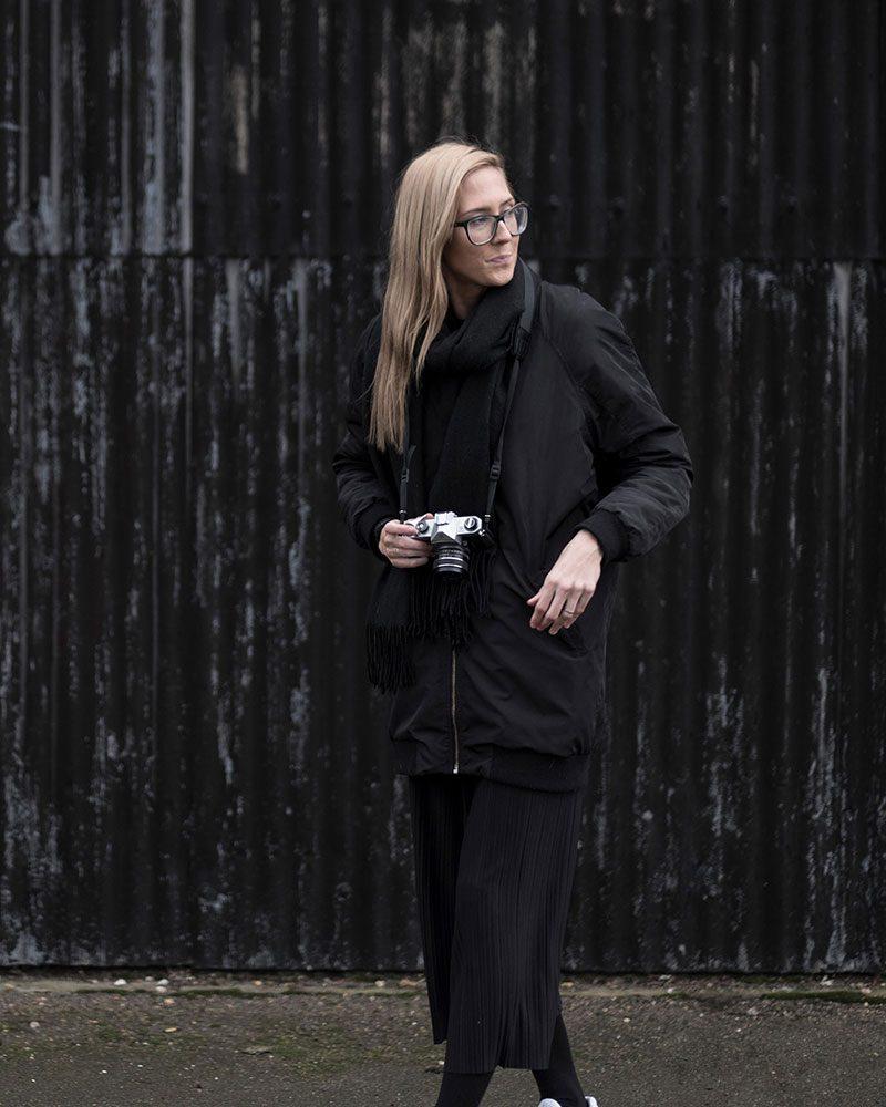 Fiona Burrage, of the Nor Folk holding a camera