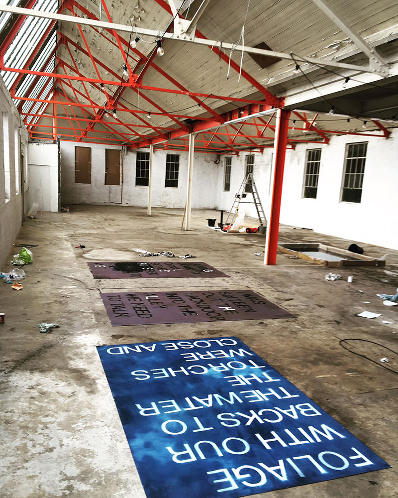 Norwich Shoe Factory showcasing work, a blue grid on the floor Matthew Benington