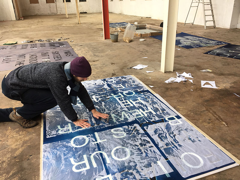 Matthew Benington prepares his work in the Norwich Shoe Factory for his solo exhibition