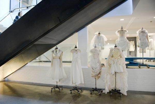 - Photograph of mannequins with white clothes inside the entrance foyer of NUA's Guntons Building