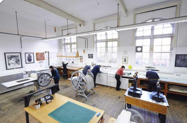 - Aerial shot of people at work in NUA's intaglio print room