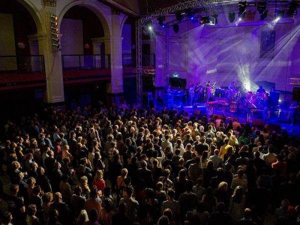Open Live Music Venue - Image of an audience from an ariel view watching a band in a large music venue