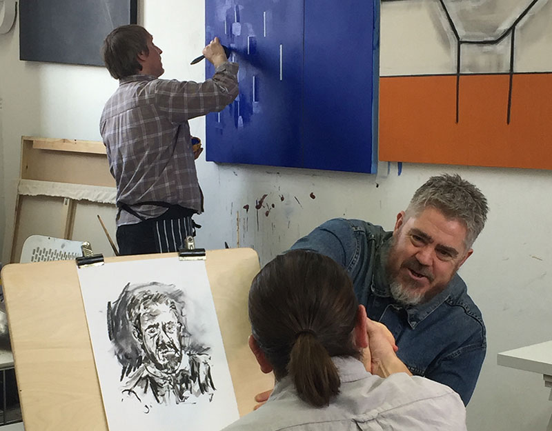 Phill Jupitus with Tom Hill in the MA Fine Art studios at Norwich University of the Arts