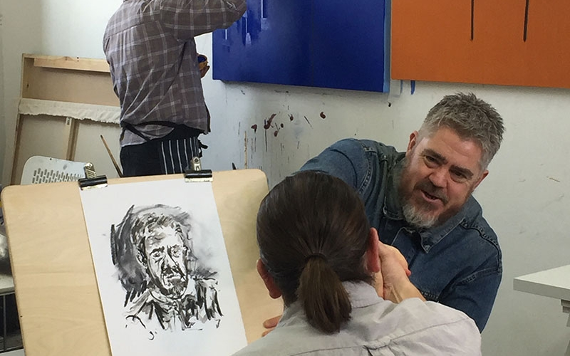Phill Jupitus with MA Fine Art student Tom Hill in the MA studios at Norwich University of the Arts
