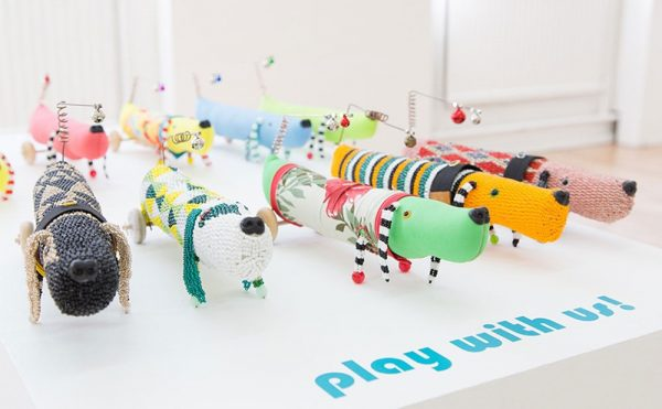Kazz Morohashi - Work by Norwich University of the Arts Research student Kazz Morohashi showing 9 dog puppets in multiple colours