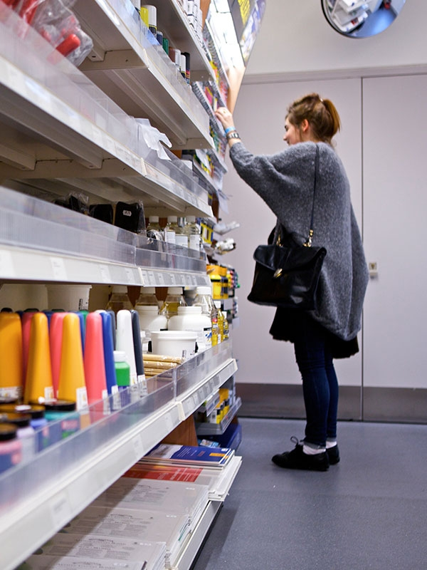 Image of a student looking at items in the NUA Shop