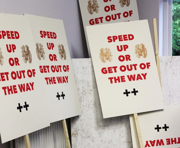 Speed Up - Photograph of several signs on sticks piled together by fine art course leader Carl Rowe