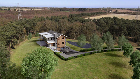 Remote Aerial Services - Aerial landscape photograph with added building by David Simpson