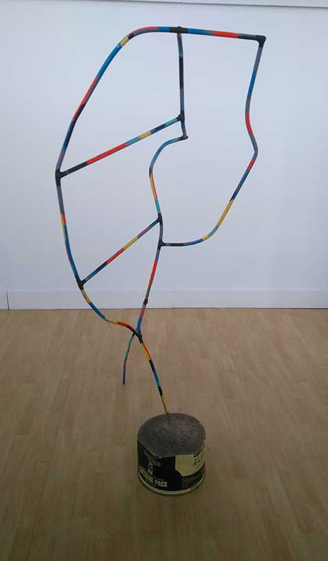 Headless in a Beat Motel- steel, enamel, adapted found container and cement, 2016 - Abstract wire sculpture painted in segments of bright colours, in a concrete base