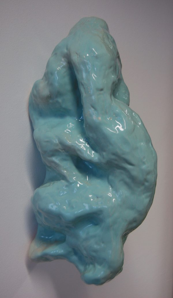 Holy Molar (spearmint version)- glazed slip cast ceramic, 2017 - Pale green glazed ceramic lumpy sculpture attached to the wall