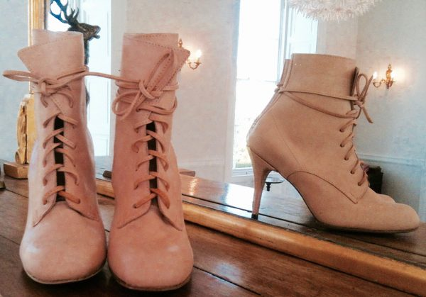 Design Consultancy, 2015 - Pair of high heeled pale pink lace up ankle boots from the front, stood next to a mirror so a side angle can also be viewed