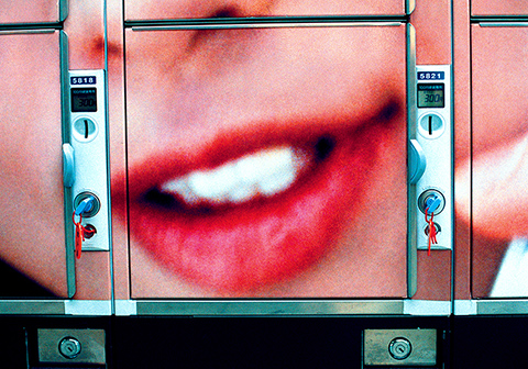 Untitled - Close up photograph of a smiling mouth with red lips
