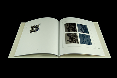 To-ing - An image of an open book with white pages on a black background. On the left page are four small squares making up a larger square, and the same on the right but larger in size