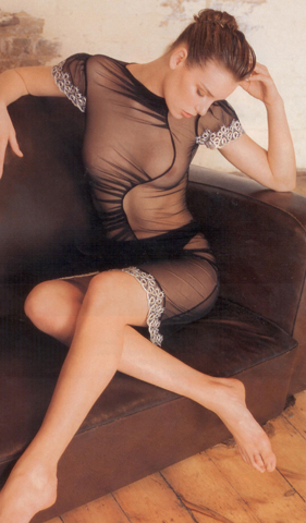 Garment - Photograph of a woman on a sofa in a black mesh dress by Sue Chowles